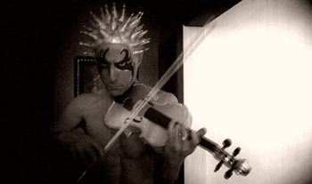 Paul Festa as Stringendo in Festa's silent-film comedy The Glitter Emergency